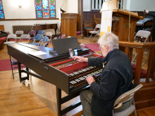 Willard Martin, one of the foremost harpsichord 	builders in our time, tuning his harpsichord before our concert. Sunday, May 12, 2019.