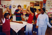 Donna Messer gives a lecture demonstration to the fifth graders of the Elmora School in Elizabeth, New Jersey on the recorder through music history, providing a visual history of the recorder from pre-historic times to the present (posted on the back wall), demonstrating the range of recorders from sopranino to great bass, and encouraging the children to move to the music. February, 2004