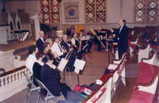 John Eisenhauer conducts a dress rehearsal of the recorder section for the concert 'Soft and Suite', March 28, 2004.  Photo: John Berkhalter III, virtuoso recorder player