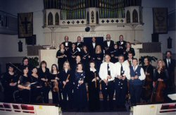 The Highland Park Recorder Society and The Garden State Sinfonia, its Chamber Orchestra and Chorus. Instrumentalists, from left: Marjorie Selden (viola), Roland Hutchinson (viola), Lea Karpman, Knarik Yeremyan, Lubove Schnable, and Etleva Vatoci (violins), Elizabeth Falconer, Lynn Gumert, Donna Messer, Russ Condon, Peter Guarnaccia, David Brookes and John Burkhalter III (recorders), Janet Walker and Linda Fink (cellos), and Ed Fleischman (double bass viol). Standing behind Lynn Gumert is Conductor John Eisenhauer.Choristers are Diane Maye Whitener, Nadine Robinson, Ellie Escher, Elizabeth Verderosa, Jean Volk, Gloria M. Kierniesky, John McBride, David Marsh, Timothy J. Smith, William S. Buela, and Robin E. Rowand. Missing from photo are Dean Paulsen and Eugene Roan, (harpsichordists), and Gideon Dabi, bass baritone. Music in the Age of Benjamin Franklin, United Methodist Church, New Brunswick, April 2, 2006.