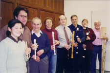 Participants at a Highland Park Recorder Society rehearsal, March, 2004. The recorders the players are holding are, from left to right, a maple sopranino, a white soprano, a black soprano (mostly hidden), an alto, a rosewood alto and maple Renaissance tenor in the hands of conductor John Eisenhauer, a Yamaha tenor, a Yamaha bass, and a modern style great bass.
